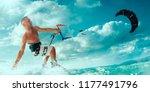 kitesurfing. man rides on kite...   Shutterstock . vector #1177491796