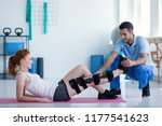 woman with leg injury on mat... | Shutterstock . vector #1177541623
