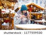 beautiful young woman drinking... | Shutterstock . vector #1177559530