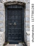 the old forged black door with... | Shutterstock . vector #1177581283