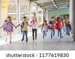 primary school kids run holding ... | Shutterstock . vector #1177619830