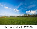 meadow and blue clody sky (can be used how backgorund) - stock photo