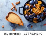cast iron pot full of plums... | Shutterstock . vector #1177634140