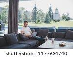 focused adult male freelancer... | Shutterstock . vector #1177634740