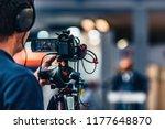 cameraman recording at media... | Shutterstock . vector #1177648870