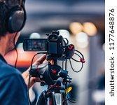 cameraman recording at media... | Shutterstock . vector #1177648876