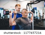 senior man lifting weights with ... | Shutterstock . vector #1177657216