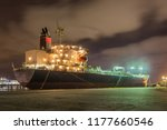 illuminated oil tanker at night ... | Shutterstock . vector #1177660546