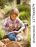 school boy in countryside trip... | Shutterstock . vector #1177666879