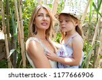 fashionable mother carrying... | Shutterstock . vector #1177666906