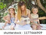 brothers and sisters sitting... | Shutterstock . vector #1177666909