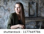 smiling long haired woman with... | Shutterstock . vector #1177669786