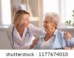 doctor visiting senior woman at ... | Shutterstock . vector #1177674010