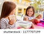 two young schoolgirls eating... | Shutterstock . vector #1177707199