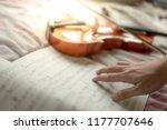 Musician Hand On Sheet Of Musi...