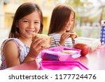 young schoolgirls holding... | Shutterstock . vector #1177724476