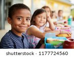 young boy and girl at school... | Shutterstock . vector #1177724560