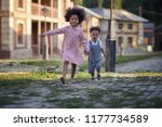 brother and sister running on... | Shutterstock . vector #1177734589