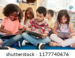 young school kids in class... | Shutterstock . vector #1177740676