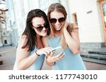 two young women looking at the... | Shutterstock . vector #1177743010