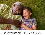 laughing boy and granddad lying ... | Shutterstock . vector #1177751290