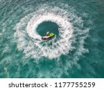 people are playing a jet ski in ... | Shutterstock . vector #1177755259