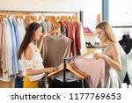 Stock photo beautiful young women choosing clothes in shop 1177769653