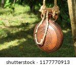 ancient clay flask hanging on a ... | Shutterstock . vector #1177770913