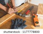 close up hands of carpenter... | Shutterstock . vector #1177778800