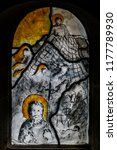 """Small photo of Rosrath, Germany - April 17 2014: Stained Glass window of Parish Church """"St Nicolaus of Tolentino"""" (german: St. Nikolaus von Tolentino)"""