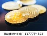 golden bitcoin and mound of... | Shutterstock . vector #1177794523