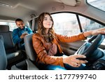 female taxi driver driving a... | Shutterstock . vector #1177799740