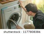 young asian technician looking... | Shutterstock . vector #1177808386