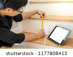 young asian worker using tape... | Shutterstock . vector #1177808413