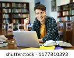 student with laptop studying in ... | Shutterstock . vector #1177810393