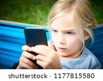 child blond girl playing with a ... | Shutterstock . vector #1177815580