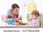 cute little girl with young... | Shutterstock . vector #1177816396