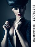 mysterious woman in black with ring and hat - stock photo