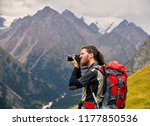 man photographer with big... | Shutterstock . vector #1177850536
