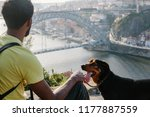 traveler african man with dog... | Shutterstock . vector #1177887559