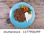 buckwheat porridge served with... | Shutterstock . vector #1177906399