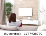 young woman watching tv in the... | Shutterstock . vector #1177928770
