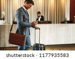 businessman standing in hotel... | Shutterstock . vector #1177935583