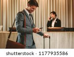 businessman walking in hotel... | Shutterstock . vector #1177935586