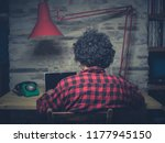 young hipster man working in... | Shutterstock . vector #1177945150
