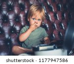 a cheeky little boy is going... | Shutterstock . vector #1177947586
