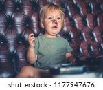 a cheeky little boy is going... | Shutterstock . vector #1177947676