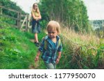 a little toddler is walking in... | Shutterstock . vector #1177950070