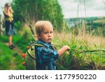 a little toddler is walking in... | Shutterstock . vector #1177950220