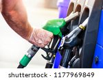 man holding pump and refueling... | Shutterstock . vector #1177969849